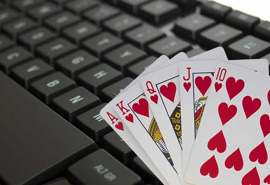 computer keyboard and playing cards